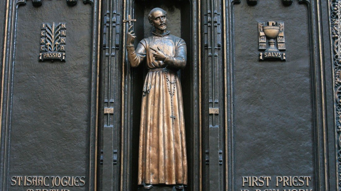 This is a statue of <strong>St. Isaac Jogues</strong>, thought to be the first Catholic priest to go to Manhattan, at New York City's St. Patrick's Cathedral. He is best known for his work as a missionary to the Huron and Algonquian nations in the area colonized by France in what is now the United States and Canada.  Jogues, who died in 1646 after he was hit with a Mohawk tomahawk, is the patron saint of the Americas and Canada.