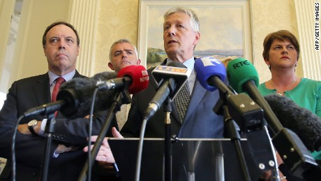 Northern Ireland First Minister Peter Robinson (3rd L) addresses the media at Stormont Castle In belfast, Northern Ireland on September 10, 2015. Northern Ireland's First Minister Peter Robinson said he was resigning on Thursday in a crisis, caused by alleged Irish Republican Army (IRA) activity, which is threatening the peace-making process. AFP PHOTO / PAUL FAITHPAUL FAITH/AFP/Getty Images