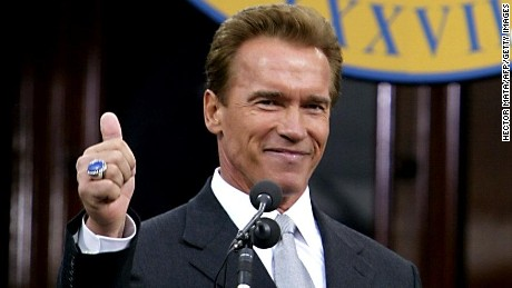 SACRAMENTO, UNITED STATES: California Governor Arnold Schwarzenegger gives a thumbs up after delivering his inaugural speech at the State Capitol in Sacramento, CA 17 November 2003. Schwarzenegger was sworn in as governor of California 17 November, vowing to immediately begin the battle of returning the shine to the battered golden state. AFP PHOTO / POOL / HECTOR MATA (Photo credit should read HECTOR MATA/AFP/Getty Images)