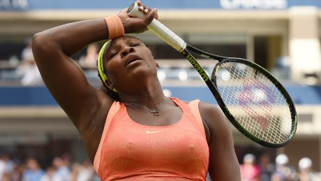 Serena Williams of the US wipes her forehead while playing Roberta Vinci of Italy during their US Open 2015 women's singles semifinals match at the USTA Billie Jean King National Center September 11, 2015  in New York. AFP PHOTO/TIMOTHY A. CLARY        (Photo credit should read TIMOTHY A. CLARY/AFP/Getty Images)