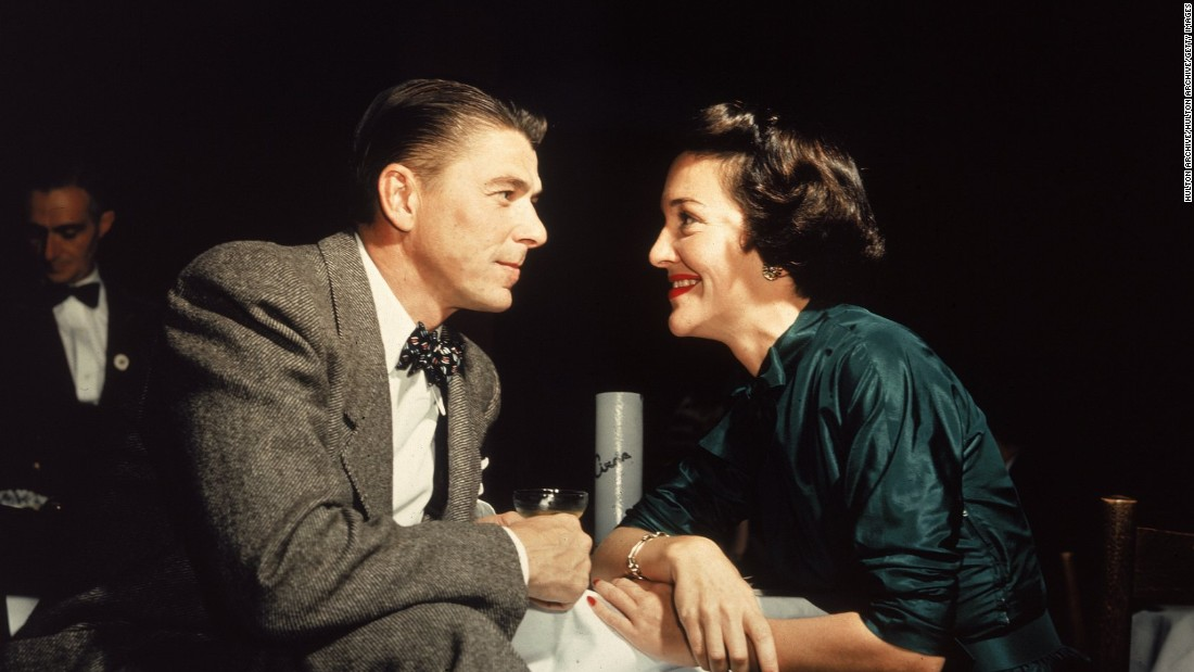 Reagan and his wife, Nancy Reagan, gaze at one another across a table in about 1952, the year they were married.