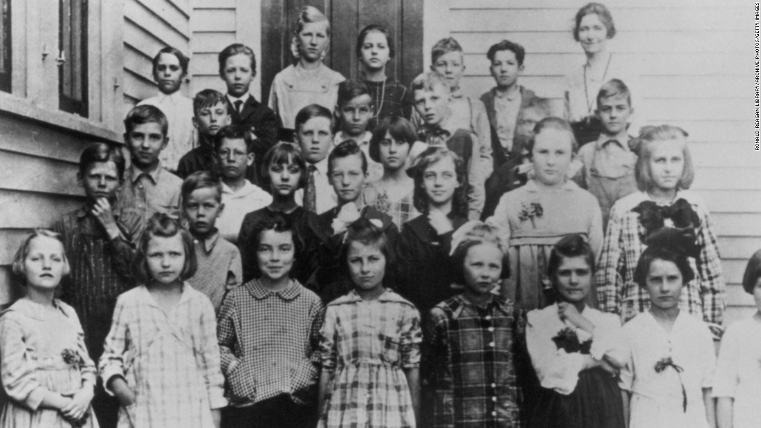 In a 1919 photo, future U.S. President Ronald Reagan (second row, left) stands with his classmates in a third-grade class portrait in Tampico, Illinois.