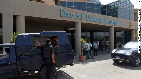 """Egyptian security members stand guard as newly appointed Tourism Minister Khaled Ramy arrives at the Dar al-Fouad Hospital in a western Cairo suburb to visit injured tourists who were mistakenly targeted by a joint police and military operation """"chasing terrorist elements"""", on September 14, 2015. Egyptian security forces have mistakenly killed 12 people including Mexican tourists while chasing jihadists in the country's vast Western Desert, drawing condemnation and calls for an investigation from Mexico. AFP PHOTO / MOHAMED EL-SHAHED        (Photo credit should read MOHAMED EL-SHAHED/AFP/Getty Images)"""