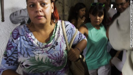 """Relatives of Mexican tourists attacked in Egypt leave towards the airport in Guadalajara, Mexico on September 14, 2015. Egyptian security forces have mistakenly killed 12 people including Mexican tourists while chasing jihadists in the vast Western Desert, sparking condemnation of what Mexico called a """"deplorable"""" air attack. Mexico called on Egypt Monday to swiftly investigate why tourists were mistakenly targeted in what witnesses described as an air strike that left at least two Mexicans dead and six unaccounted for. AFP PHOTO/HECTOR GUERRERO"""
