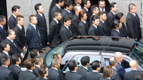 Yamaguchi-gumi members gather at their leader's funeral in Kobe, Japan.