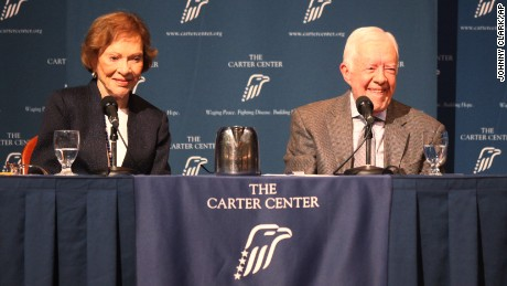 Former President Jimmy Carter and his wife, Rosalynn, spoke to the Carter Center crowd Tuesday night.