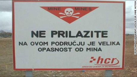 A sign in Croatia warns of landmines from the Balkan Wars in the area.