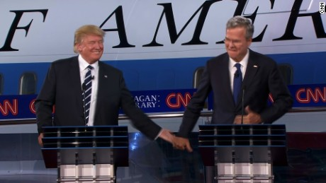 Donald Trump and Jeb Bush high-five after Bush's answer that his Secret Service codename would be Everready.