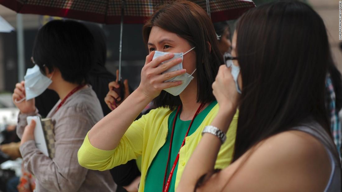 Pedestrians wear face masks in Kuala Lumpur on September 11.