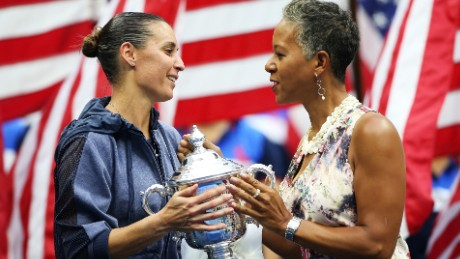 NEW YORK, NY - SEPTEMBER 12:  USTA Chairman, CEO and president Katrina Adams (R) presents the winner's trophy to Flavia Pennetta of Italy after she defeated Roberta Vinci of Italy during their Women's Singles Final match on Day Thirteen of the 2015 US Open at the USTA Billie Jean King National Tennis Center on September 12, 2015 in the Flushing neighborhood of the Queens borough of New York City. Pennetta defeated Vinci 7-6, 6-2.  (Photo by Matthew Stockman/Getty Images)