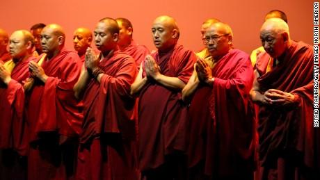 Buddhist monks chant at Prabal Gurung.