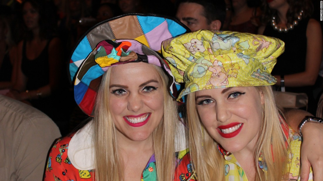 """Bloggers """"The Beckerman Sisters"""" donning colorful hats and matching frocks at the Jeremy Scott show"""