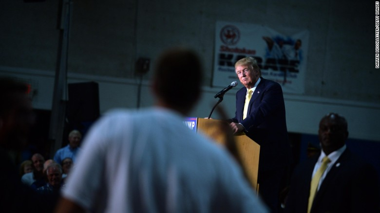 Republican presidential candidate Donald Trump listens to a question during a town hall event in Rochester, New Hampshire.