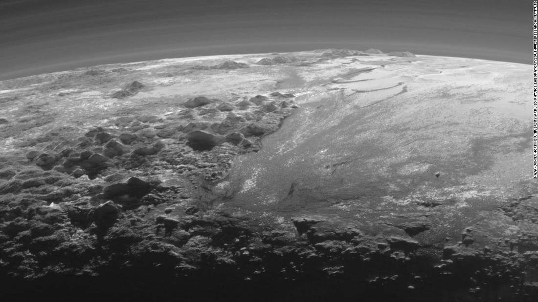 "This image of Pluto's icy and mountainous landscapes was taken from a distance of 11,000 miles (17,700 kilometers). ""This image really makes you feel you are there, at Pluto, surveying the landscape for yourself,"" said New Horizons Principal Investigator Alan Stern of the Southwest Research Institute in Colorado."