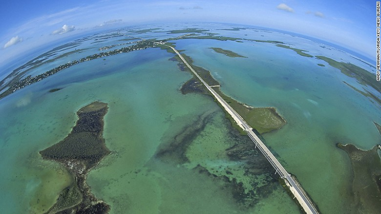 Completed in 1912, Florida's Overseas Highway bisects the Atlantic Ocean to the east (left), and the Gulf of Mexico to the west (right).