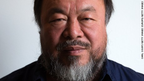 LONDON, ENGLAND - SEPTEMBER 11: Chinese artist Ai Weiwei poses for a photograph after a press conference at the Royal Academy of Arts on September 11, 2015 in London, England. Ai Weiwei spoke to the media ahead of his forthcoming exhibition at the Academy which runs from September 19 to December 13, 2015. (Photo by Carl Court/Getty Images)