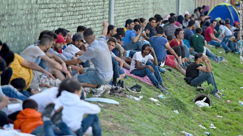 TOVARNIK, CROATIA - SEPTEMBER 19:  Migrants seek shade from the sun as they  wait at Tovarnik for transport to take them north despite moves by Slovenia and Hungary to hold them back on September on September 19, 2015 in Tovarnik, Croatia.Thousands of migrants are trying back roads and tracks through villages to gain access to Slovenia and the EU since Hungary fenced off its border with Serbia earlier this week.  (Photo by Jeff J Mitchell/Getty Images)