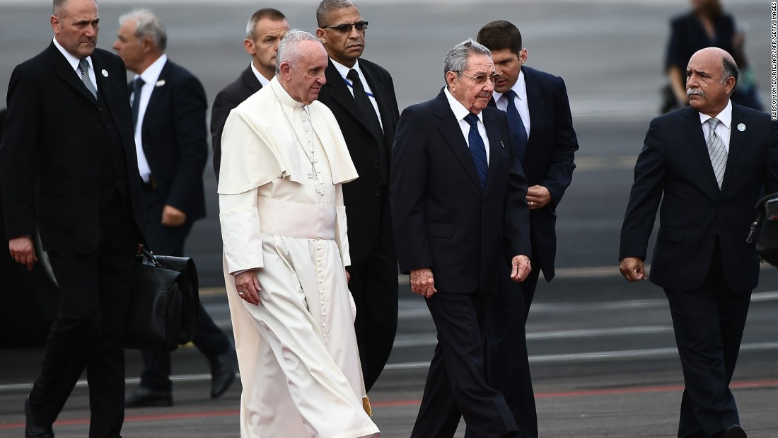 Cuban President Raul Castro walks with the Pope after his arrival on September 19.