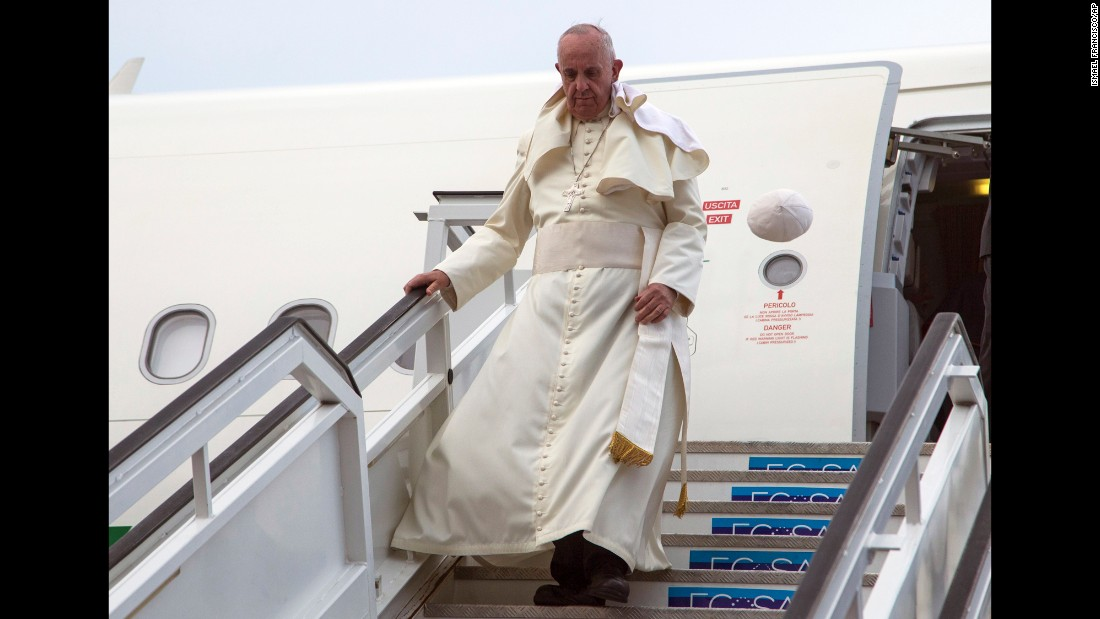 Pope Francis' cap flies off his head as he deplanes in Havana on September 19.
