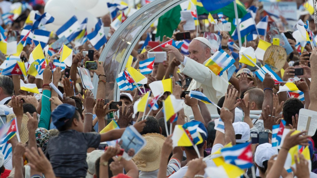 Crowds surround the Pope as he arrives in Revolution Square on September 20.