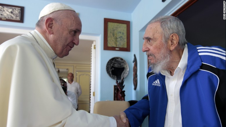 Pope Francis and Fidel Castro shake hands on Sunday afternoon.