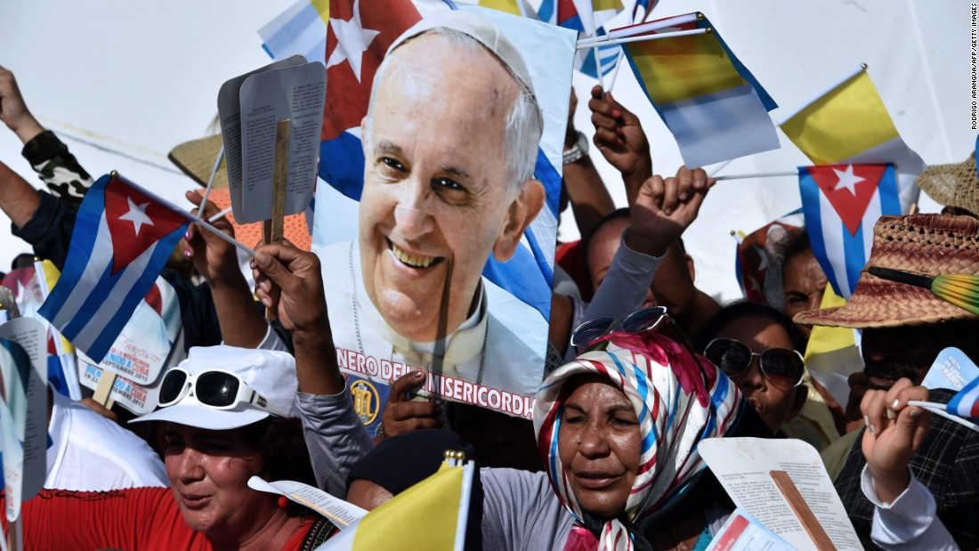 People cheer in Holguin as Pope Francis arrives for the Mass on September 21.