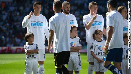 Zaid (L) stands with Cristiano Ronaldo and his teammates -- all wearing T-shirts in support of Syrian refugees.
