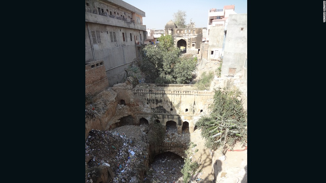 """I always show this baoli, or stepwell, as an example and reminder of how a unique, awe-inspiring, formerly essential monument can be reduced to rubble. I had to climb on a roof to even see the extent of this marvel, one of the largest I've encountered, and which must have been an incredible sight hundreds of years ago. Now it's surrounded by buildings, used as a dump, and no-one has any idea it's there. It made me cry."""""""