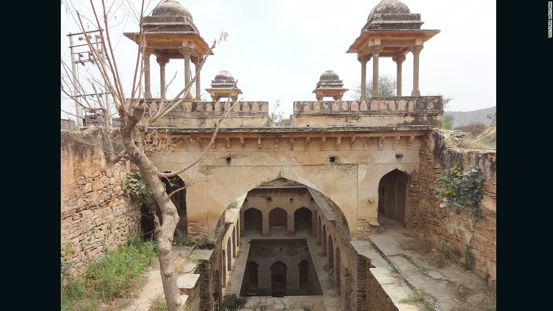 """""""It's not easy getting to this small stepwell in the fields outside the city of Narnaul, with its many spectacular Mughal monuments. But the dirt road eventually lead to pretty -- if overgrown -- stepwells, with its four chattris that come into view. What a peaceful spot in its day - I'm sorry this one's such a ruin."""""""