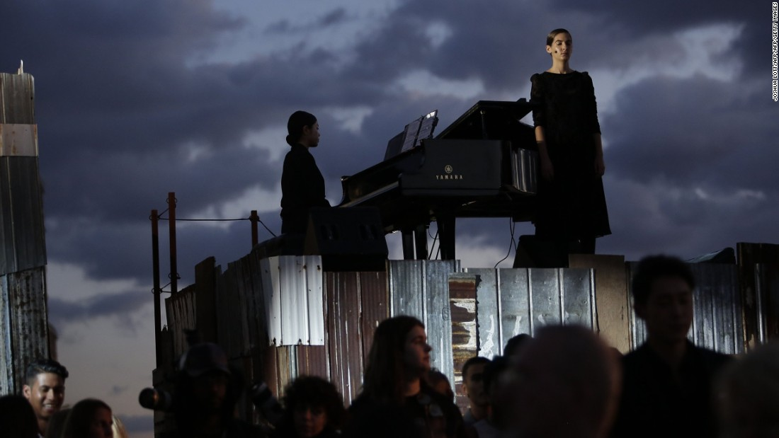 A pianist and singer perform during the show.