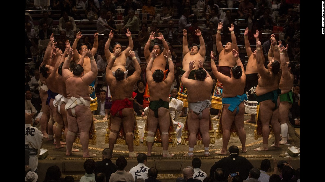 "Wrestlers enter the ring during the Tokyo Grand Sumo tournament on Thursday, September 17. <a href=""http://www.cnn.com/2015/09/15/sport/gallery/what-a-shot-sports-0915/index.html"" target=""_blank"">See 44 amazing sports photos from last week</a>"