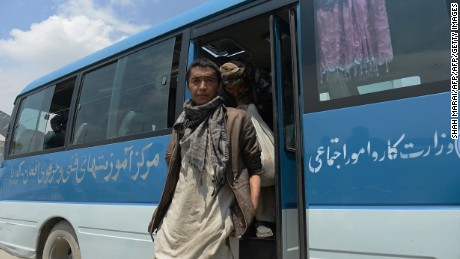 Afghan drug addicts arrive by bus to register their names during a campaign by the NEJAT drug treatment centre in Kabul on April 20, 2014. The NEJAT Centre is an Afghan response to vulnerable Afghan people, working with the communities for the prevention, treatment and care of drug users and HIV/Aids patients. Afghanistan produces around 90 percent of all opiate drugs in the world, but only recently became a major consumer - out of a population of 35 million, more than a million are now addicted to drugs.  AFP PHOTO/SHAH Marai        (Photo credit should read SHAH MARAI/AFP/Getty Images)