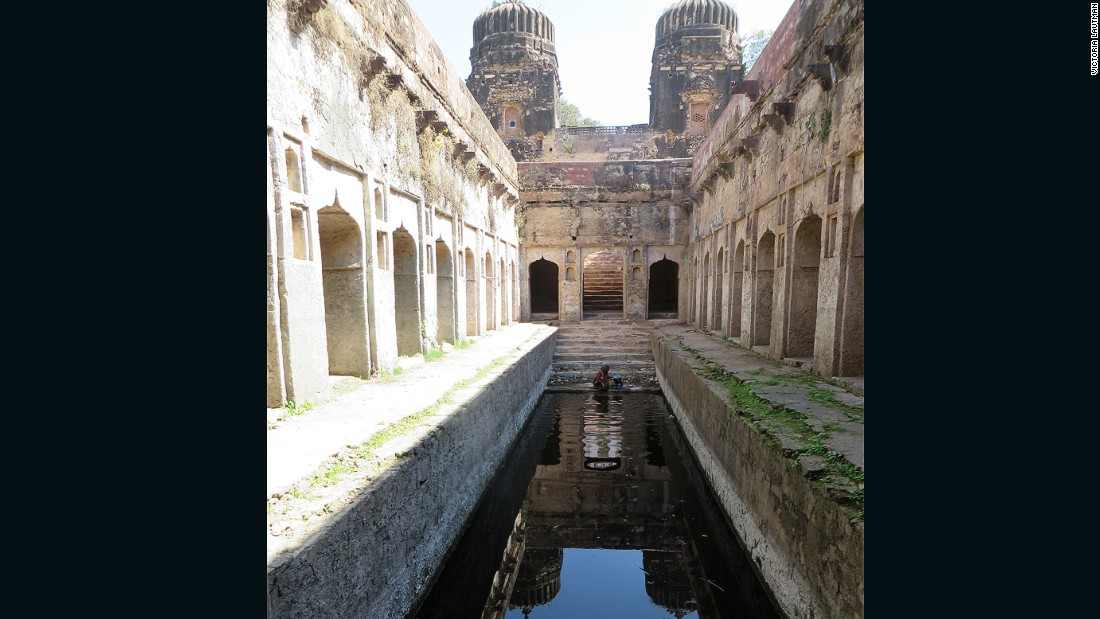 """""""A farm family cares for this stepwell, using it as it was in past centuries: for drinking, washing, and irrigation. It's large scale, huge entry towers, and architectural details make it another of my favorites -- an unexpected treasure way out in the countryside."""""""
