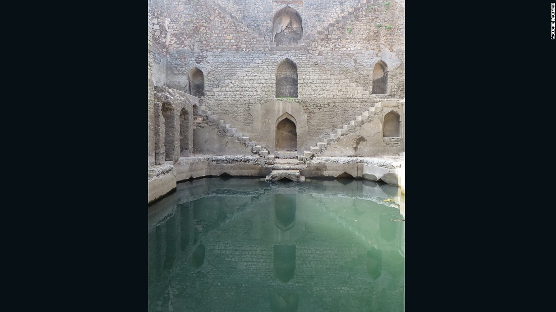 """""""The fort at Mandu has a number of stepwells, tanks, and sophisticated water-harvesting systems but none as beautiful as Ujala baoli. The picture doesn't show what an odd, asymmetrical structure it really is, or it's sadly dilapidated state."""""""