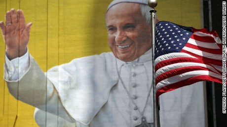 NEW YORK, NY - SEPTEMBER 21:  A  completed mural of Pope Francis is viewed on the side of a building in midtown Manhattan on September 21, 2015 in New York City. The Pope will be making his first trip to the United States on a three-city, five-day tour that will begin in Washington on September 22, then travel to New York City and Philadelphia. The Pope will depart on September 27.  (Photo by Spencer Platt/Getty Images)