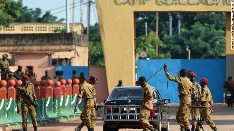 Burkina Faso army troops stand guard in September after army troops entered the capital Ouagadougou without resistance and began negotiating the surrender of coup leaders.