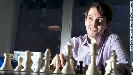 Martin Shkreli, chief investment officer of MSMB Capital Management, sits behind a chess board in New York, U.S., on Wednesday, Aug. 10, 2011. MSMB made an unsolicited $378 million takeover bid for Amag Pharmaceuticals Inc. and said it will fire the drugmaker's top management if successful.