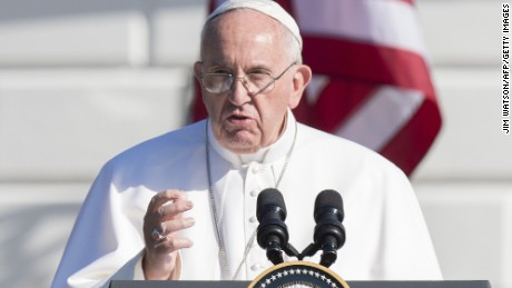 Pope Francis speaks during an arrival ceremony on the South Lawn of the White House in Washington, DC, September 23, 2015. More than 15,000 people packed the South Lawn for a full ceremonial welcome on Pope Francis' historic maiden visit to the United States. AFP PHOTO / JIM WATSON        (Photo credit should read JIM WATSON/AFP/Getty Images)