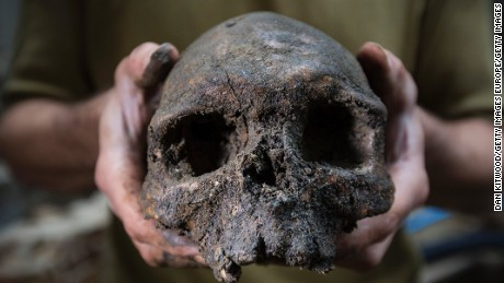 LONDON, ENGLAND - SEPTEMBER 21:  A skull forms part of a collection of bones that were found among the stepped footings of Westminster Abbey's south transept, on September 21, 2015 in London, England. The footings were built from Reigate stone between 1246 and1250, during the reign of Henry III, and back filled with charnel material comprising mostly of femurs and skulls from earlier burials. The square hole on the skull is likely from pick axes used to dig out the bones in the 13th century. The area is currently being excavated as part of the transform of part of the 13th-century Triforium into a new viewing and gallery area that will be open to the public for the first time. As well as exhibiting many historical objects from the abbey, the new £19m GBP space will give visitors views down over the abbey buildings and the neighbouring Palace of Westminster. The work is due to be completed by 2018  (Photo by Dan Kitwood/Getty Images)