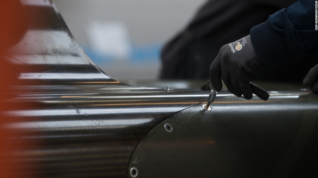 Engineers work on the carbon-fibre body of the Bloodhound SSC.