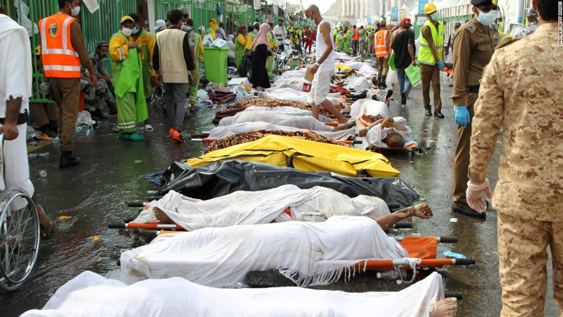 "Saudi emergency personnel surround bodies of Hajj pilgrims at the site of a stampede Thursday, September 24, in Mecca, Islam's holiest city. Thursday morning's stampede killed hundreds during one of the last rituals of the<a href=""http://www.cnn.com/2015/09/23/world/gallery/hajj/index.html""> Hajj, the annual Islamic pilgrimage</a>."