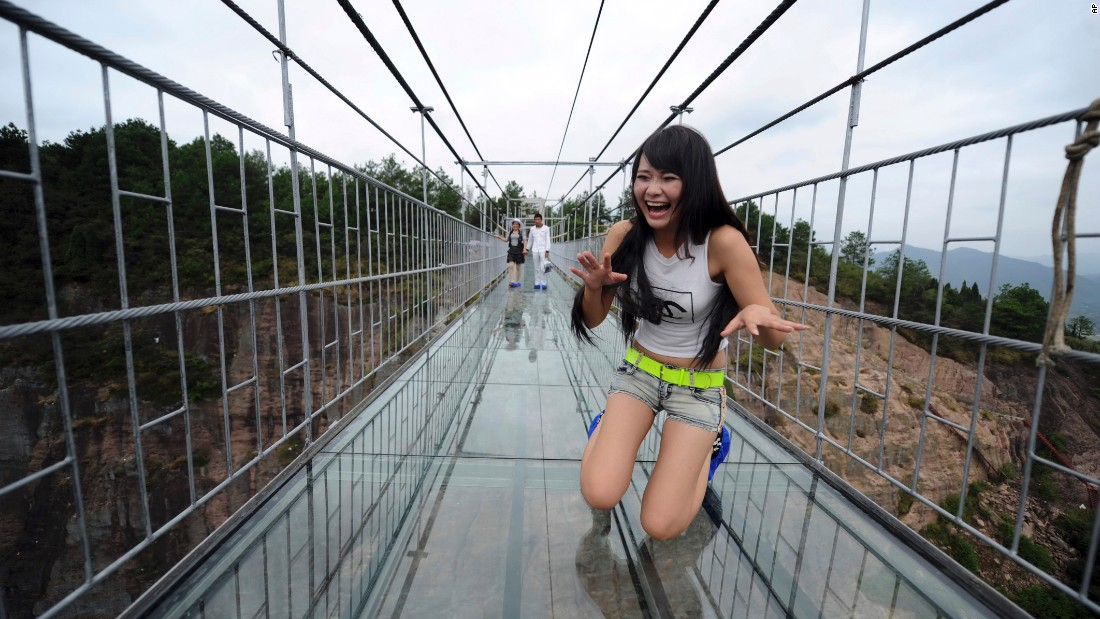 It's called Haohan Qiao -- Brave Men's Bridge in English. The 300-meter-long overpass in Shiniuzai National Park in southern China has a bottom made of glass, allowing walkers to see the stomach-churning view below their feet.
