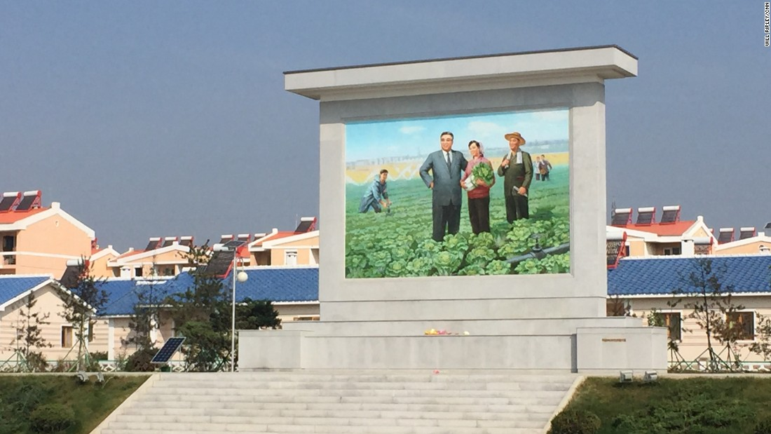 "A large mural of North Korean founder Kim Il Sung stands outside the Jang Chon cooperative farm, a 30-minute drive outside the capital Pyongyang. <a href=""http://www.cnn.com/2015/09/25/asia/north-korea-most-famous-farmer/"">CNN visited the farm in September, 2015.</a>"