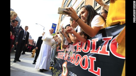 Pope Francis greets guests upon his arrival at Our Lady Queen of Angels School on September 25 in the East Harlem neighborhood of New York City.