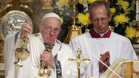 Pope Francis blesses the Blood of Christ during a Mass at Cathedral Basilica of Sts. Peter and Paul, Saturday, September 26, 2015, in Philadelphia.