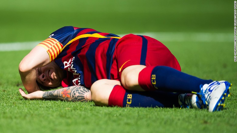 Lionel Messi lays injured on the pitch during the La Liga match between FC Barcelona and Las Palmas at the Nou Camp.
