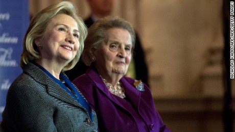 Former US Secretaries of State Hillary Clinton (L) and Madeleine Albright listen to a speaker after Clinton received the 2013 Lantos Human Rights Prize during a ceremony on Capitol Hill in Washington on December 6, 2013.   AFP PHOTO/Nicholas KAMM        (Photo credit should read NICHOLAS KAMM/AFP/Getty Images)