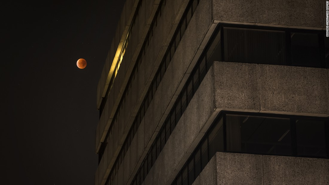 "Photography student <a href=""http://ireport.cnn.com/docs/DOC-1273190"">Annemiek Schout</a> captured this photo of the supermoon eclipse from The Hague, Netherlands. ""Even though I expected the moon to be bigger -- like I've seen before -- it was a magical experience,"" Schout said."