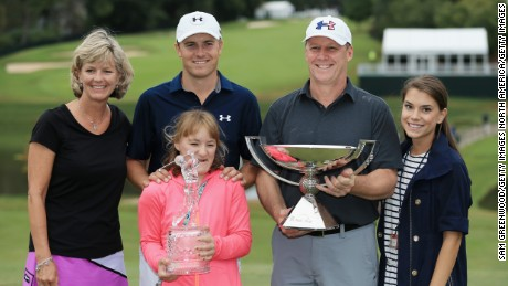 ATLANTA, GA - SEPTEMBER 27:  Jordan Spieth of the United States poses on the 18th green with his mom Chris, father Shawn, sister Ellie and girlfriend Annie Verret after winning both the TOUR Championship By Coca-Cola and the FedExCup at East Lake Golf Club on September 27, 2015 in Atlanta, Georgia  (Photo by Sam Greenwood/Getty Images)
