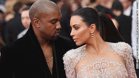 """NEW YORK, NY - MAY 04:  Kanye West (L) and Kim Kardashian attend the """"China: Through The Looking Glass"""" Costume Institute Benefit Gala at the Metropolitan Museum of Art on May 4, 2015 in New York City.  (Photo by Mike Coppola/Getty Images)"""